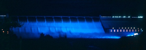 Colored light show on Grand Coulee Dam