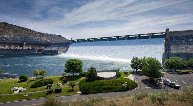 Grand Coulee Dam with water spilling over the spillway